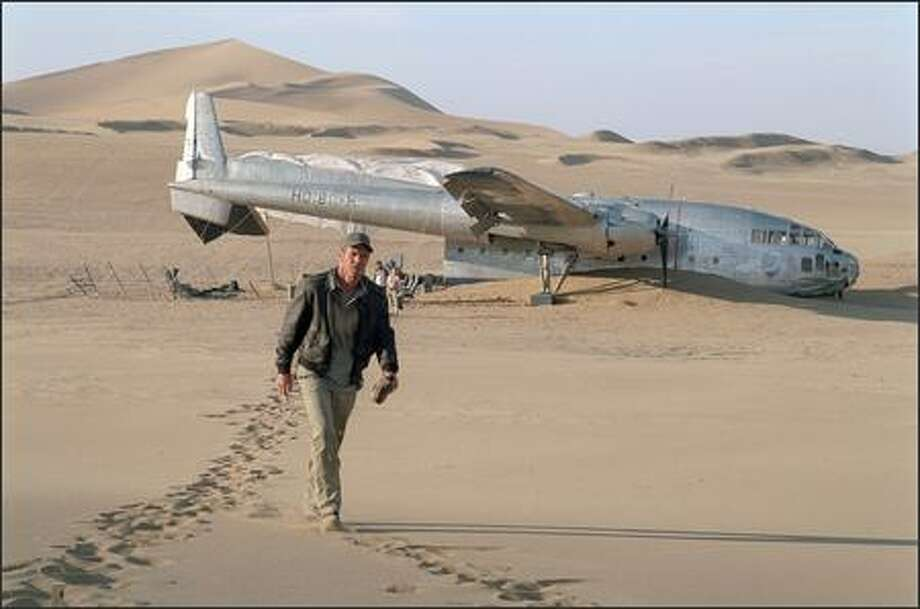 Cargo plane pilot Frank Towns (Dennis Quaid) is evacuating the staff of an oil exploration operation in Mongolia when a sandstorm cripples his plane, forcing him to crash in the Gobi Desert in midsummer. Photo: Fox