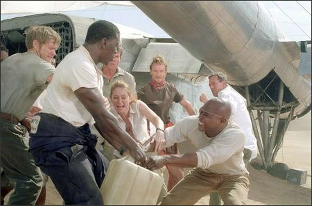 Stranded with limited provisions, the surviving passengers of the downed plane struggle over their most precious commodity: water. Pictured, left to right, are: Scott Michael Campbell as Liddle, Tyrese Gibson as co-pilot AJ, Miranda Otto as Kelly, Dennis Quaid as pilot Towns, Tony Curran as Rodney, Kirk Jones as Jeremy, and Hugh Laurie as Ian.