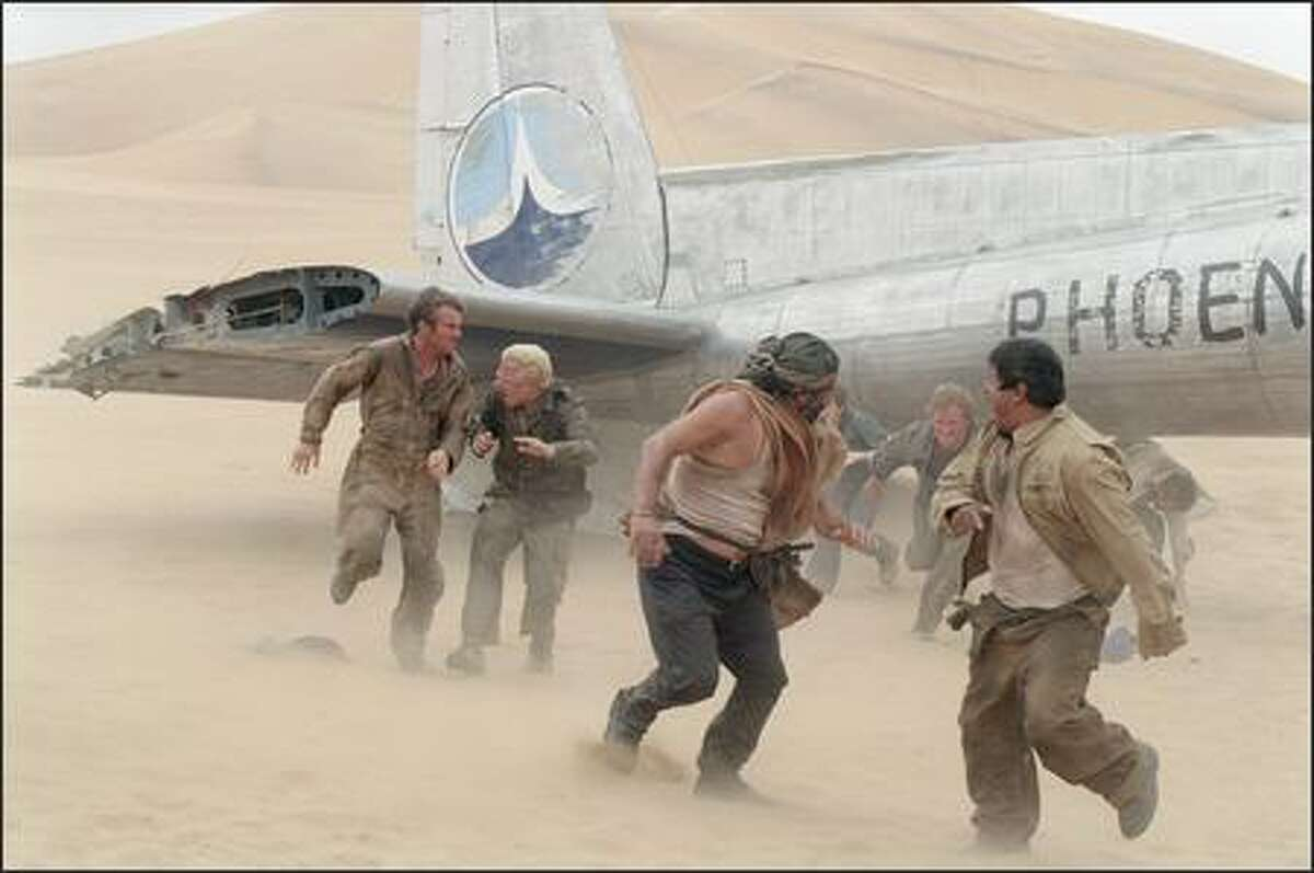 The harsh environment and weather of the Gobi Desert wreak havoc on the survivors, including (left to right) Towns (Dennis Quaid), Elliott (Giovanni Ribisi), Rady (Kevork Malikyan), Kelly (Miranda Otto), Liddle (Scott Michael Campbell), Sammi (Jacob Vargas) and Ian (Hugh Laurie). Maurauding desert smugglers further complicate their lives.