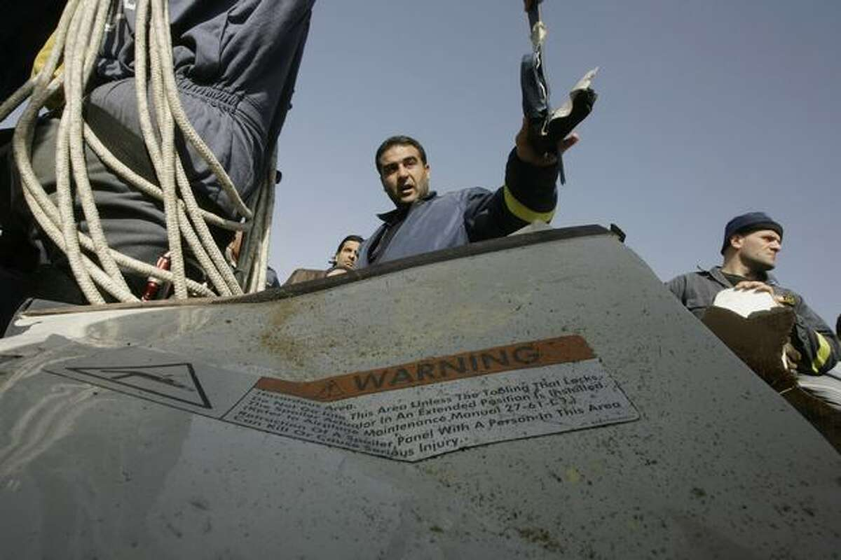 Lebanese civil defense workers recover debris from the Ethiopian airliner that crashed off Lebanon's coast in the Beirut southern coastal suburb of Khaldeh on Jan. 29, 2010.