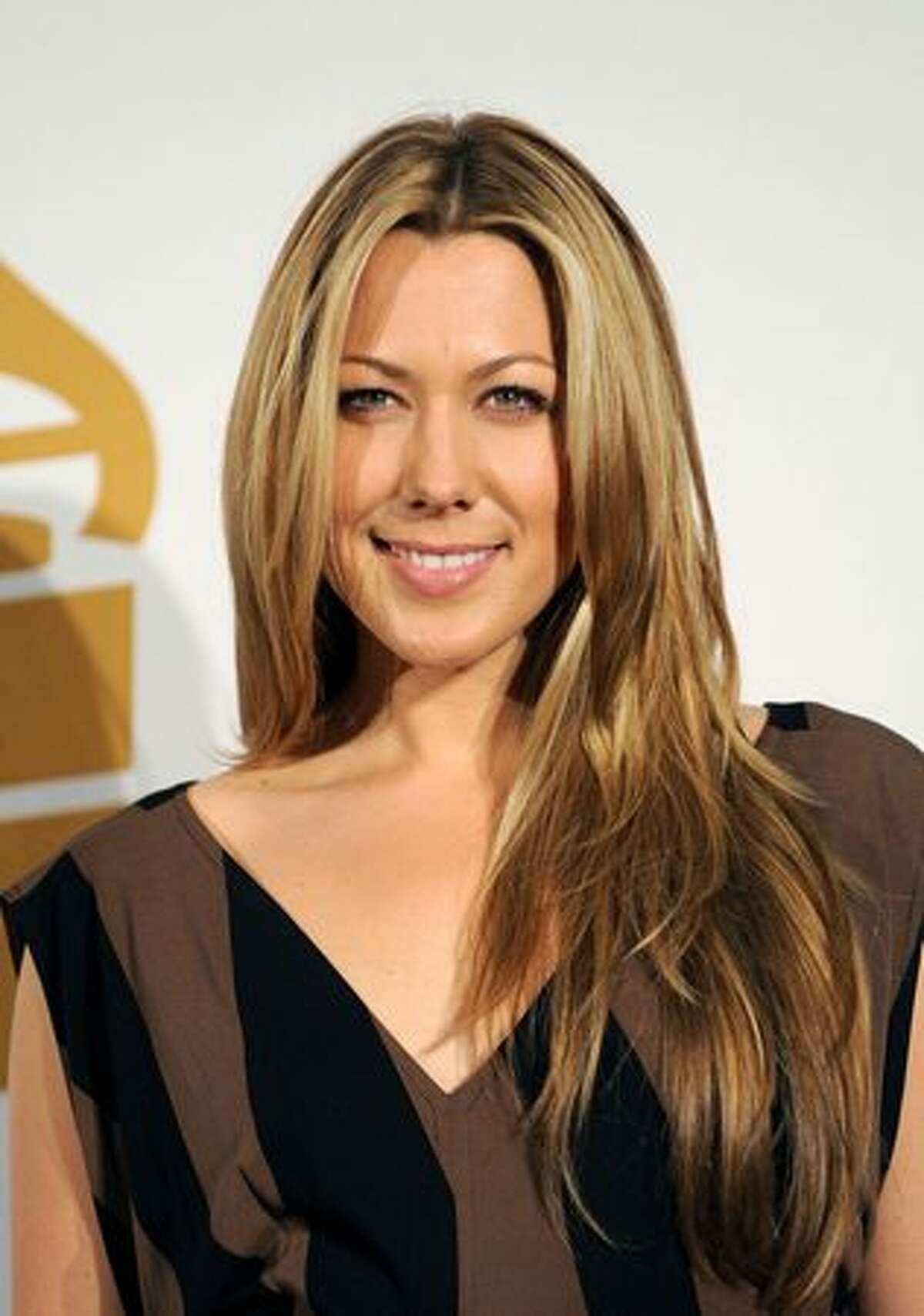 Singer Colbie Caillat poses in the press room during The GRAMMY Nominations Concert Live! at the Club Nokia on December 2, 2009 in Los Angeles, California.