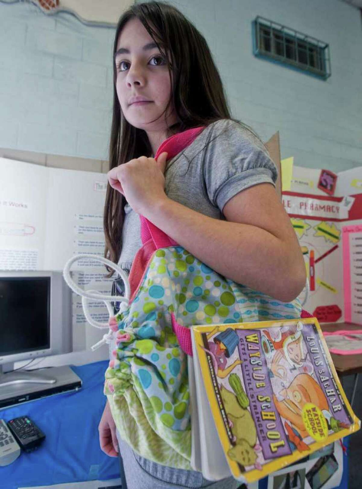 Rackell Souza created a purse with a bookmark to keep the page while holding the book. 20 fifth graders at Shelter Rock School presented inventions that they created at the school. They will take the inventions to Western Connecticut State University's Westside Campus Center Ballroom on Thursday. Monday, April 4, 2011