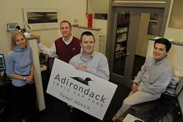 Adirondack Funds Alicia Lasch, left, Steve Gonick, 2nd from left, Matt Reiner, 3rd from left, and Greg Roeder, far right, pose in their office on Wednesday, April 6, 2011 in Guilderland, NY. Lasch is an analyst with the company, Gonick is the chief marketing officer, and Reiner and Roeder are the co-portfolio managers. The Adirondack Small Cap Fund was started by Reiner and Roeder. The fund has been awarded a 2011 Lipper Fund Award. (Paul Buckowski / Times Union)