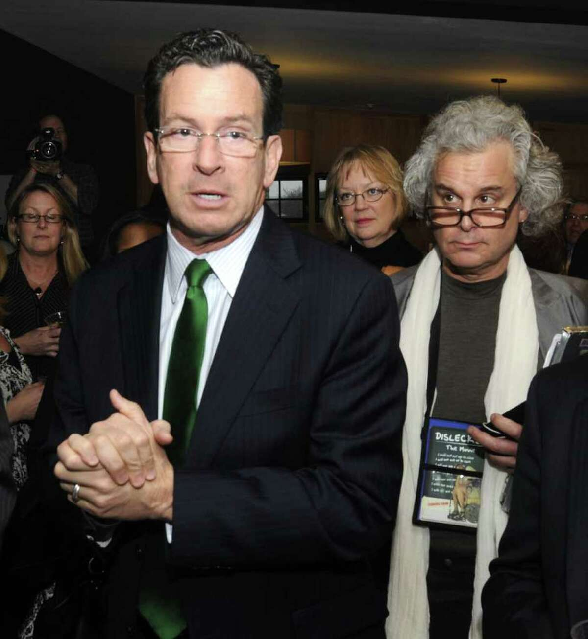 Connecticut Governor Dannel Malloy, left, talks about his dyslexia, during a pre-party for the opening of the 4th Annual Connecticut Film Festival, in Danbury, on Wednesday, April 6, 2011. Harvey Hubble V, right, is the producer of
