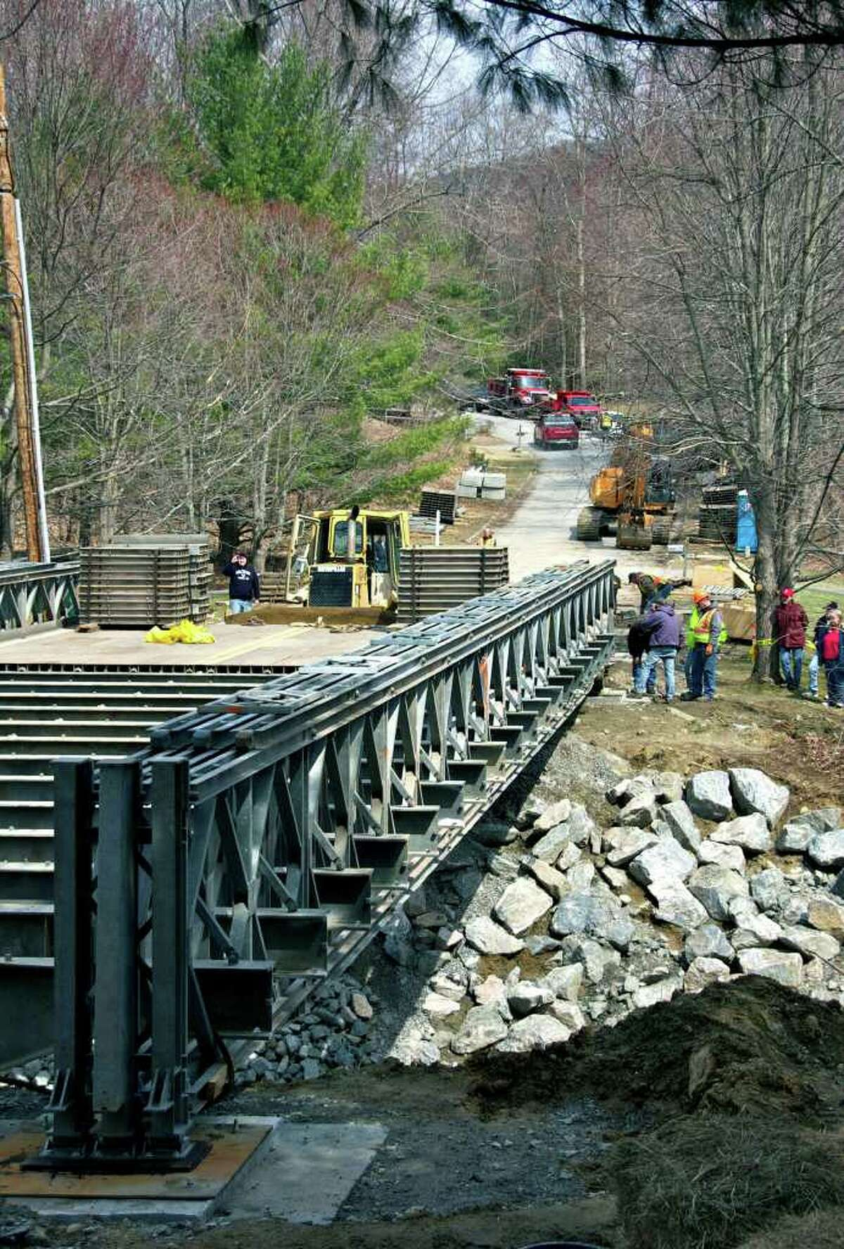 A view from near neighboring Putnam Road shows a temporary bridge spanning the Merryall Book on Chinmoy Lane, Wednesay, April 6, 2011.