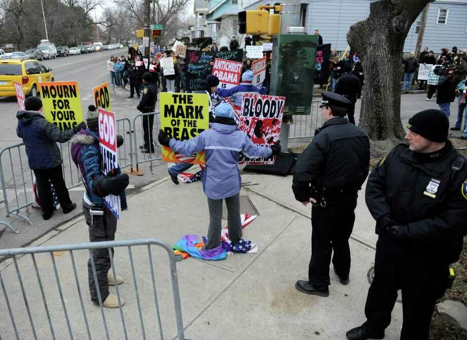 A small number of members of the Westboro Baptist Church that were present at the intersection of W. Erie and Washington Avenue across the street from Albany High School in Albany, New York March 6, 2009 and were met with a large number of protestors from opposite views on the other side of the street.    (Skip Dickstein / Times Union)A small number of members of the Westboro Baptist Church that were present at the intersection of W. Erie and Washington Avenue across the street from Albany High School in Albany, New York March 6, 2009 and were met with a large number of protestors from opposite views on the other side of the street.    (Skip Dickstein / Times Union) Photo: SKIP DICKSTEIN / 2008
