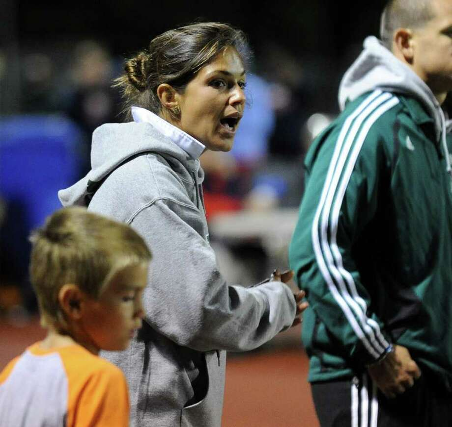 Norwalk Head Coach Jessica Stamos instructs a player, during soccer action against McMahon at McMahon High School in Norwalk, Conn. on Wednesday September 15, 2010. Photo: Christian Abraham, ST / Connecticut Post