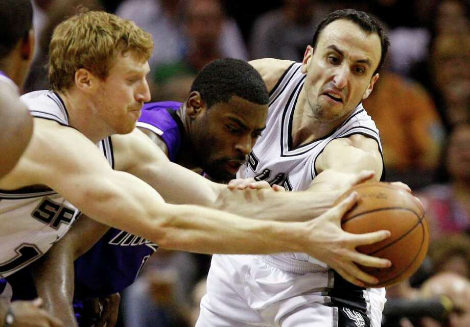 SPURS -- San Antonio Spurs Matt Bonner, left, and Manu Ginobili steal the ball away from Sacramento Kings Tyreke Evans during the second half at the AT&T Center, Wednesday, April 6, 2011. The Spurs won124-92. JERRY LARA/glara@express-news.net Photo: JERRY LARA, San Antonio Express-News / SAN ANTONIO EXPRESS-NEWS (NFS)
