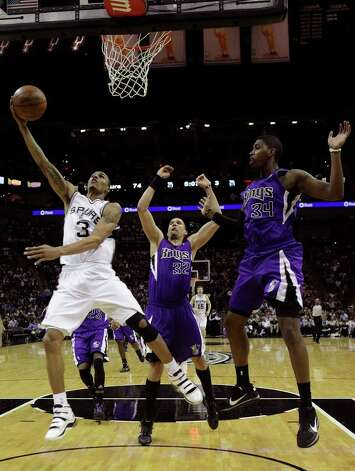 SPURS -- San Antonio Spurs George Hill drives by Sacramento Kings Francisco Garcia, center, and Jason Thompson during the second half at the AT&T Center, Wednesday, April 6, 2011. The Spurs won124-92. JERRY LARA/glara@express-news.net Photo: JERRY LARA, San Antonio Express-News / SAN ANTONIO EXPRESS-NEWS (NFS)