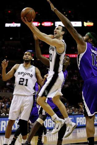 SPURS -- San Antonio Spurs Tim Duncan watches as teammate Manu Ginobili heads to the goal past Sacramento Kings Samuel Dalembert, center, and DeMarcus Cousins, right, during the first half at the AT&T Center, Wednesday, April 6, 2011. JERRY LARA/glara@express-news.net Photo: JERRY LARA, San Antonio Express-News / SAN ANTONIO EXPRESS-NEWS (NFS)