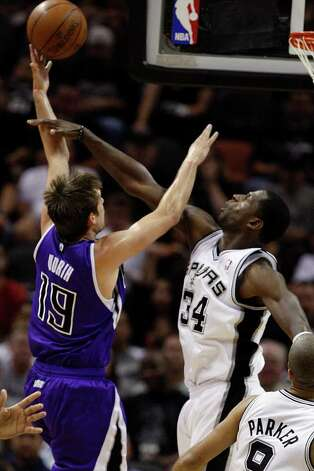 SPURS -- San Antonio Spurs Antonio McDyess tries to stop Sacramento Kings Beno Udrih during the first half at the AT&T Center, Wednesday, April 6, 2011. JERRY LARA/glara@express-news.net Photo: JERRY LARA, San Antonio Express-News / SAN ANTONIO EXPRESS-NEWS (NFS)
