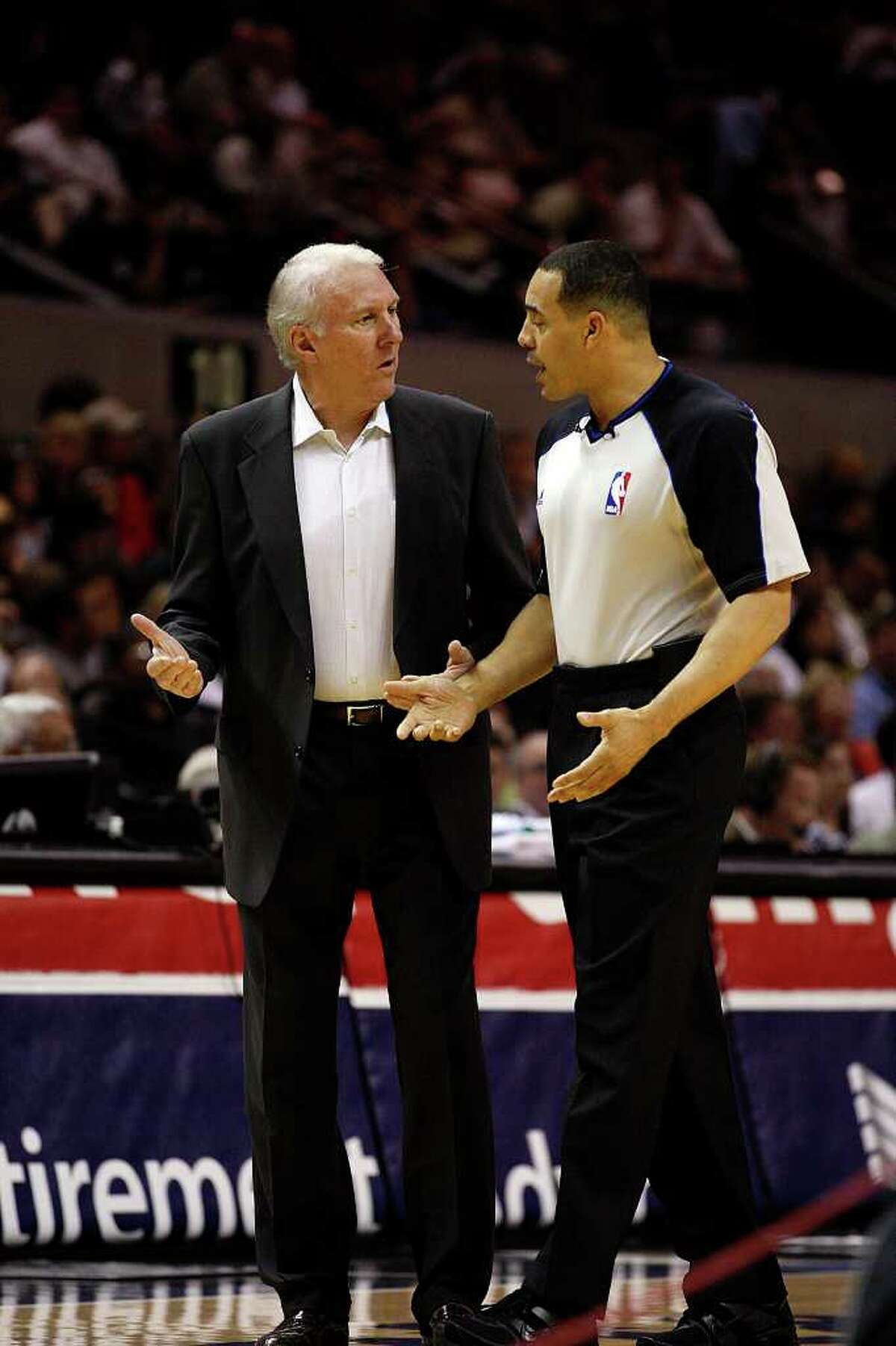 SPURS -- San Antonio Spurs Head Coach Gregg Popovich discusses a call with Official Curtis Blair in the first half against the Sacramento Kings at the AT&T Center, Wednesday, April 6, 2011. JERRY LARA/glara@express-news.net