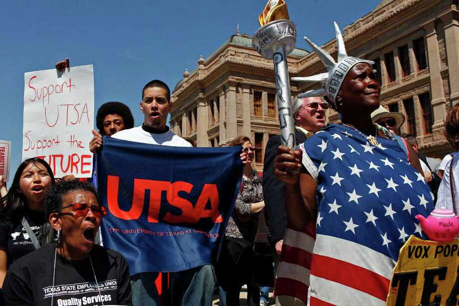 UTSA students including Xavier Johnson (left) and Rene Amaya (center), cheer with Peace Washington Costanzo, (right), of Dale, during the Save our State rally at the State Capital in Austin on April 6. Photo: LISA KRANTZ / SAN ANTONIO EXPRESS-NEWS