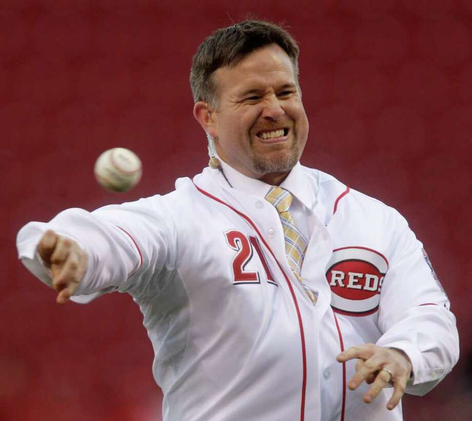 Former Cincinnati Reds player Sean Casey throws a ceremonial first pitch prior to the Reds' baseball game against the Houston Astros, Tuesday, April 5, 2011, in Cincinnati. Casey, who also played for the Tigers, Red Sox, Pirates and Indians, is joining the Reds television broadcast crew. Photo: AP
