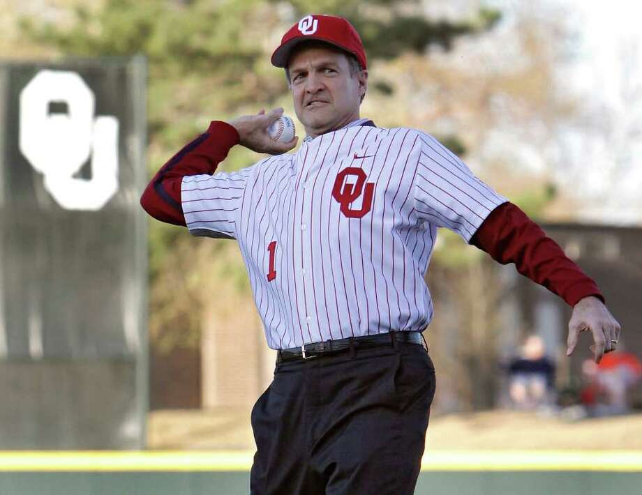 University of Oklahoma men's basketball coach Lon Kruger throws out the first pitch during the Bedlam baseball game between the University of Oklahoma Sooners (OU) and the Oklahoma State University Cowboys (OSU) on Tuesday, April 5, 2011, in Norman, Okla. Photo: AP