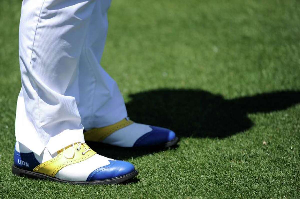 AUGUSTA, GA - APRIL 07: The shoes of amateur Lion Kim are seen while he stands on the second hole during the first round of the 2011 Masters Tournament at Augusta National Golf Club on April 7, 2011 in Augusta, Georgia. (Photo by Harry How/Getty Images)