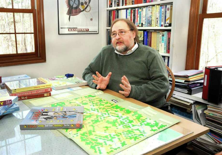 Retired history teacher Robert Markham displays some of the Civil War games he has designed. Photo taken in New Milford on April 6, 2011. Photo: James Burns III / The News-Times Freelance