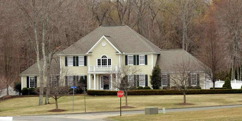 This nine-room house at 2 Empire Lane in Bethel is where Mark Mansa lived from the time it was bought in April 1996 until August 2010, when he moved out as part of the condition of his divorce from his ex-wife Susan. Photo: File Photo/ Michael Duffy, File Photo / The News-Times File Photo