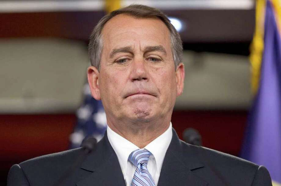House Speaker John Boehner of Ohio pauses during a news conference on Capitol Hill in Washington, Thursday, April 7, 2011. (AP Photo/Evan Vucci) Photo: Evan Vucci, AP / AP