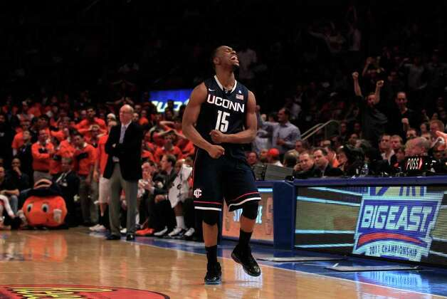 NEW YORK, NY - MARCH 11: Kemba Walker #15 of the Connecticut Huskies celebrates after a play late in the second half against the Syracuse Orange during the semifinals of the 2011 Big East Men's Basketball Tournament presented by American Eagle Outfitters at Madison Square Garden on March 11, 2011 in New York City.  (Photo by Chris Trotman/Getty Images) Photo: Chris Trotman, ST / 2011 Getty Images