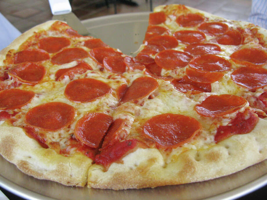 The pepperoni pizza from Deco Pizzeria has a medium think crust and packs plenty of flavor. JENNIFER McINNIS / EXPRESS-NEWS