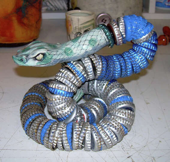 Linda Gossett willbe selling bottle-cap snakes and other creations at Fiesta Arts Fair. COURTESY