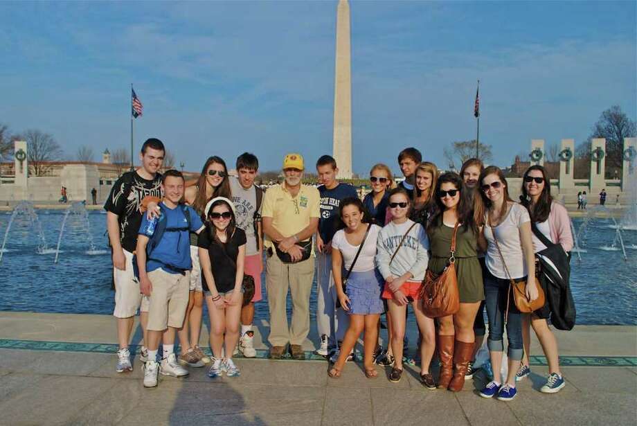 Students in teacher James D'acosta's American history class stand with a Vietnam War veteran from the Vietnam Veterans Memorial Fund during a recent trip to  war memorials in Washington, D.C. Photo: Contributed Photo