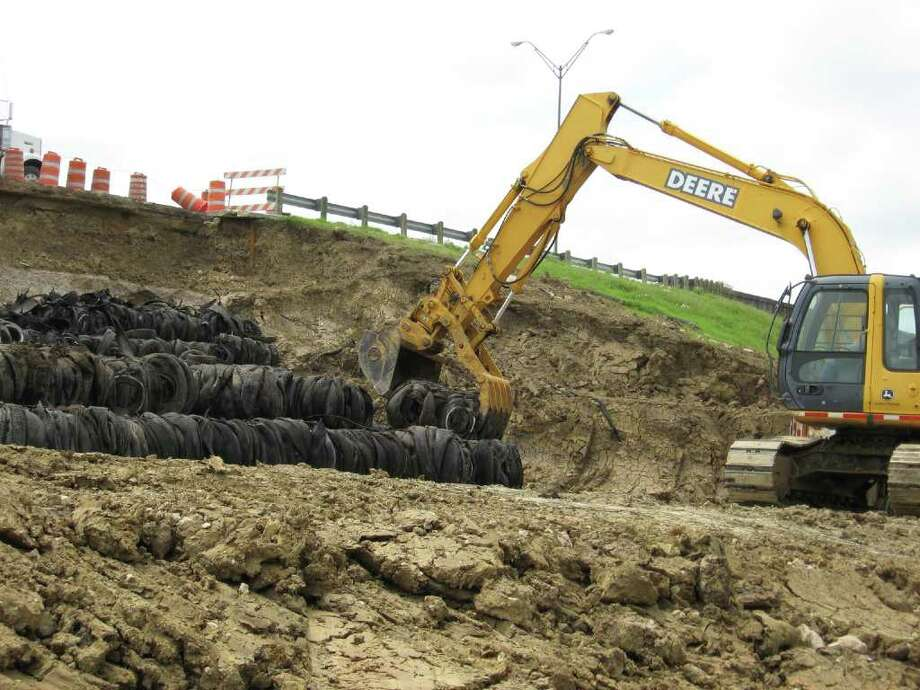 The Texas Department of Transportation is using bundles of 13,000 to 15,000 old tires to control erosion along U.S. 69's Avenue A overpass. Mike D. Smith/The Enterprise Photo: Mike D. Smith