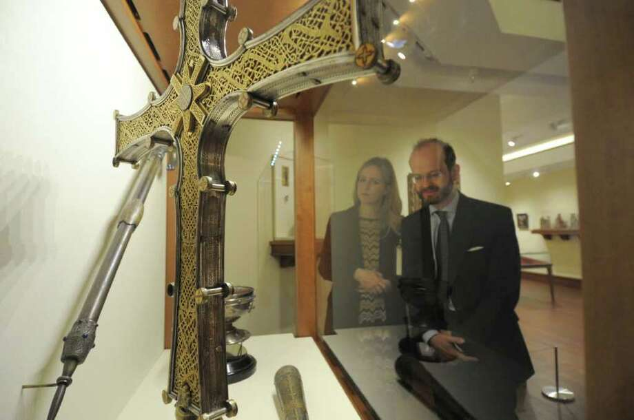 The Lady and Lord Nicholas Windsor (son of the Duke of Kent and great-grandson of King George V of the United Kingdom) view a replica of the 12th century Cross of Cong during a recent visit to the Bellarmine Museum of Art at Fairfield University. The piece is part of a new exhibit on Medieval Irish art that opens April 18.  Looking at the exhibit are Lady Paola & Lord Nicholas Windsor of England. Photo: Contributed Photo / Connecticut Post Contributed