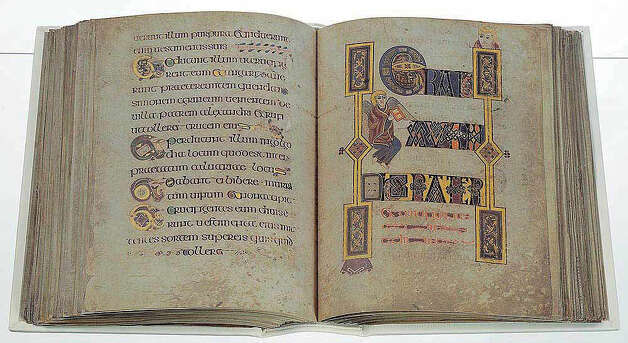 Shown are pages from a facsimile Book of Kells, a book of gospels from the monastery of Kells, in County Meath, Ireland, that was begun around 800. This copy, costing about $18,000, is one of 1,480 editions produced in 1990 in Lucerne, Switzerland. It was donated to Fairfield University's DiMenna-Nyselius Library by the Wild Geese Society of Greenwich. Photo: Contributed Photo / Connecticut Post Contributed