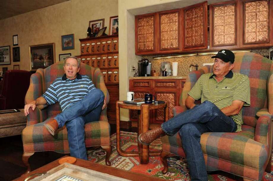 Tom P. Cusick Jr., a local entrepreneur, left, and country music singer George Strait.  Cusick opened the more than 700-acre Estancia at Thunder Valley, just south of Tapatio Springs, and was the founder of Benefit Planners, a third-party health benefits administrative firm that was sold in 2001.  PHOTO BY GREG HARRISON.