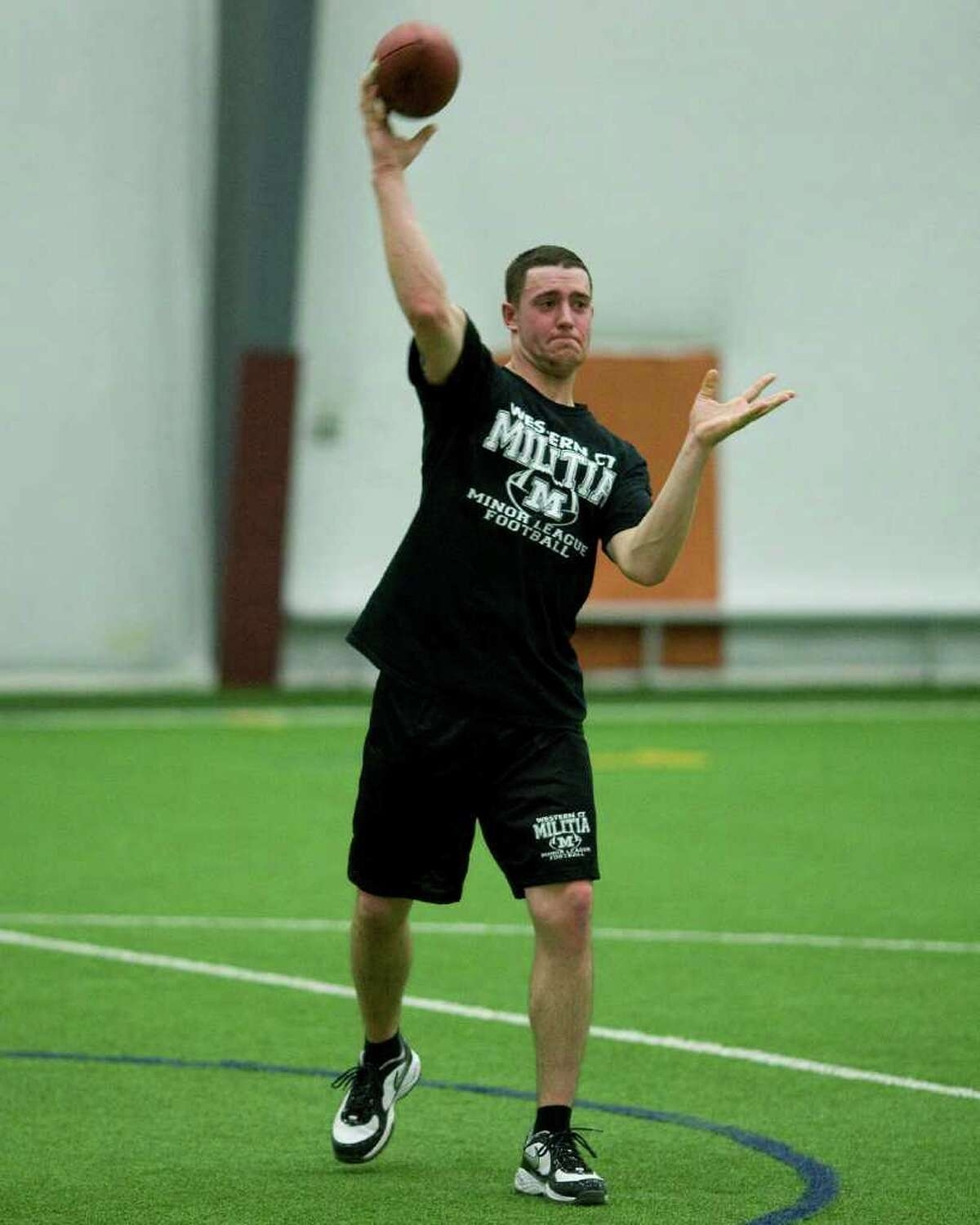 New Milford High graduate Kevin Oberg fires a pass during the training camp opener of Western Connecticut Militia Thursday night at the Newtown Youth Academy.