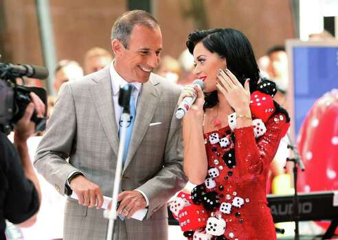 "NEW YORK - JULY 24:  Anchorman Matt Lauer talks with singer Katy Perry after Perry's performance on NBC's ""Today"" at Rockefeller Center on July 24, 2009 in New York City.  (Photo by Michael Loccisano/Getty Images) *** Local Caption *** Katy Perry Photo: Michael Loccisano, Getty Images / 2009 Getty Images"