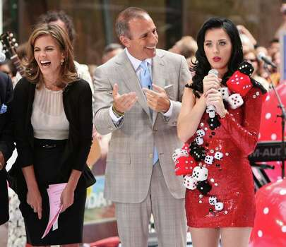 "NEW YORK - JULY 24:  Anchors Natalie Morales and Matt Lauer talk with singer Katy Perry after Perry's performance on NBC's ""Today"" at Rockefeller Center on July 24, 2009 in New York City.  (Photo by Michael Loccisano/Getty Images) *** Local Caption *** Natalie Morales;Matt Lauer;Katy Perry Photo: Michael Loccisano, Getty Images / 2009 Getty Images"