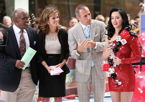 "NEW YORK - JULY 24:  Anchors Al Roker, Natalie Morales and Matt Lauer talk with singer Katy Perry after Perry's performance on NBC's ""Today"" at Rockefeller Center on July 24, 2009 in New York City.  (Photo by Michael Loccisano/Getty Images) *** Local Caption *** Al Roker;Natalie Morales;Matt Lauer;Katy Perry Photo: Michael Loccisano, Getty Images / 2009 Getty Images"