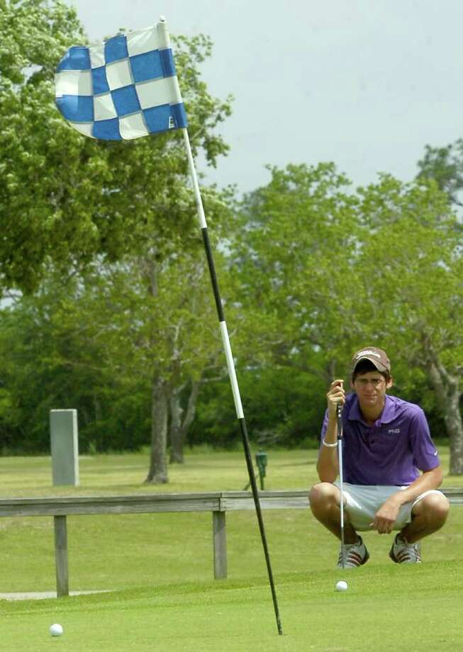Lonnie Labove, a Port Neches-Groves golfer, checks over the grass between his ball and the cup during play Thursday in the District 20-4A golf tournament at Bayou Din golf course.   Dave Ryan/The Enterprise Photo: Dave Ryan / Beaumont