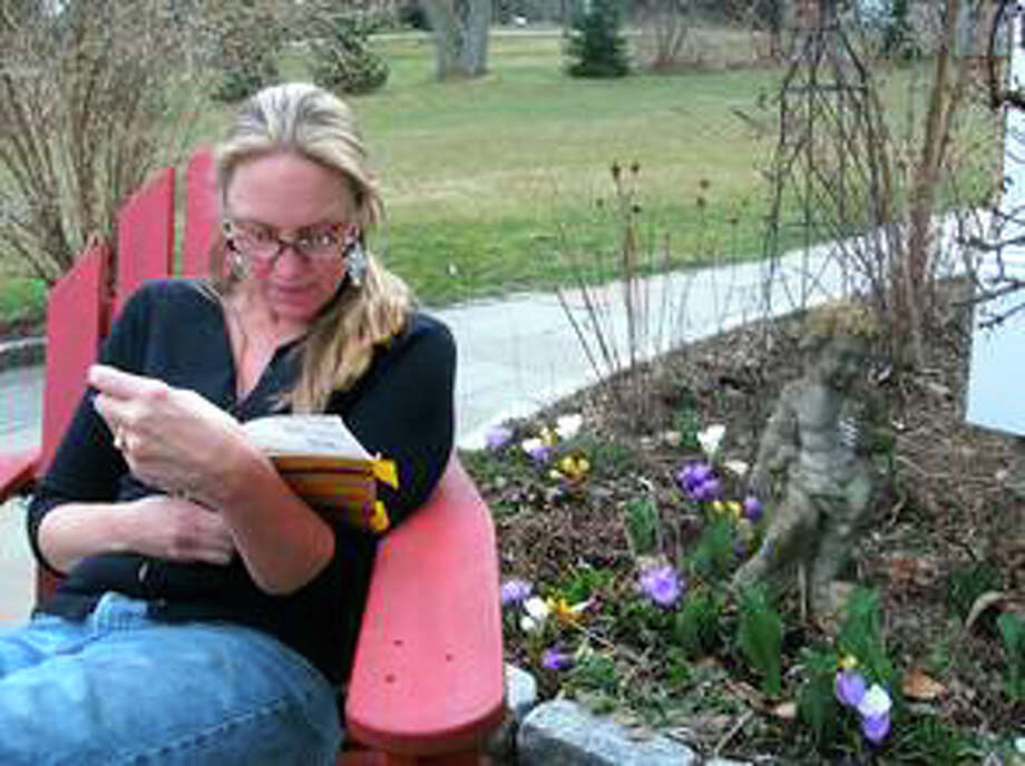 "Westport resident Nina Sankovitch reads one of the 365 books she read over the course of a year following her sister's death, which she chronicles in her first book, ""Tolstoy and the Purple Chair: My Year of Magical Reading. Photo: Contributed Photo / Westport News contributed"