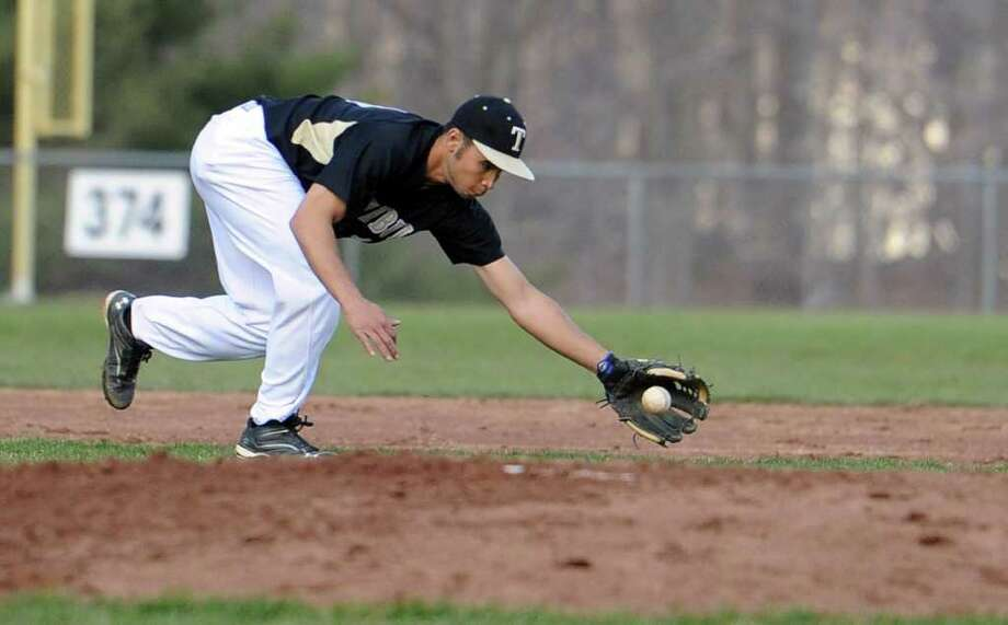 Trumbull's Casey Mack fields a ball during Thursday's game in Monroe on April 7, 2011. Photo: Lindsay Niegelberg / Connecticut Post