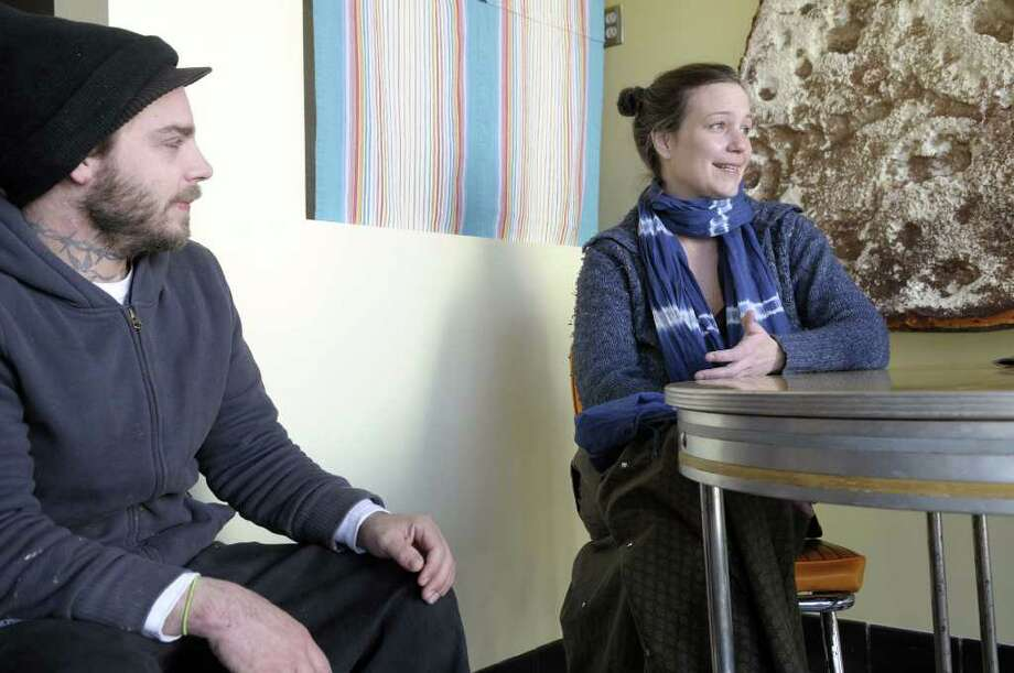 From left, Nick Foster and his wife Britin Foster talk about opening their new bakery as they sit inside their business, All Good Bakers, on Quail St. on Thursday morning, April 7, 2011 in Albany, NY.  (Paul Buckowski / Times Union) Photo: Paul Buckowski  / 00012676A