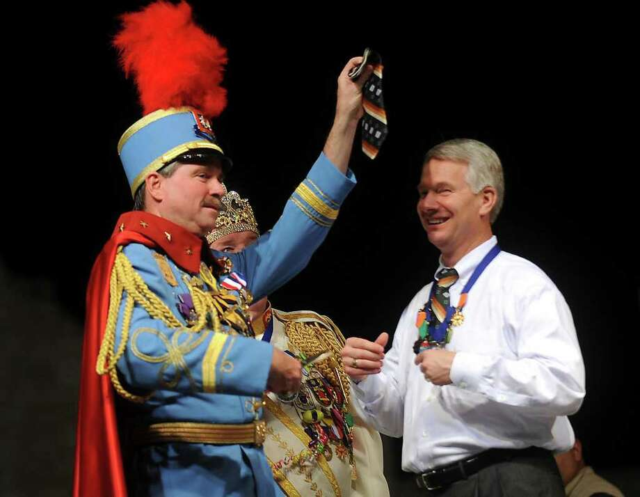 Sam Dawson of the Greater San Antonio Chamber of  Commerce has his tie cut by Bill Mitchell, who is Fiesta King Antonio, during the Fiesta San Antonio 2011 opening ceremony in Alamo Plaza on April 7. Photo: BILLY CALZADA / gcalzada@express-news.net