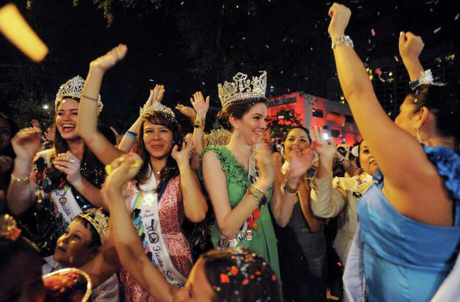 Fiesta San Antonio 2011 Queen Lauren Holt (left), and other Fiesta royalty celebrate as confetti and fireworks are shot into the air during the Fiesta San Antonio 2011 opening ceremony in Alamo Plaza on April 7. Photo: BILLY CALZADA / gcalzada@express-news.net