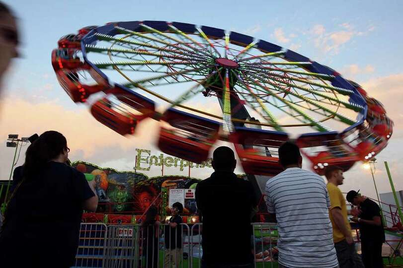 Visitors to the Fiesta Carnival watch the Enterprise April 7 at the Alamodome.