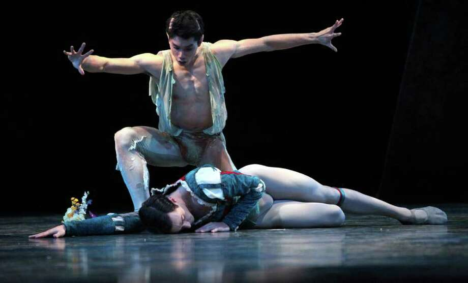 """Pacific Northwest Ballet corps de ballet dancers Eric Hipolito Jr. (as Puck) and  Jerome Tisserand (as Lysander) perform during a dress rehearsal for George Balanchine's """"A Midsummer Night's Dream."""" Photo: Joshua Trujillo / Seattlepi.com"""