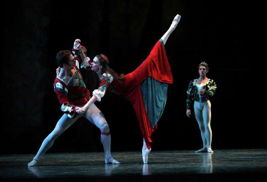 """Pacific Northwest Ballet company dancers Jeffrey Stanton, Kylee Kitchens and  Lucien Postlewaite perform during a dress rehearsal for George Balanchine's """"A Midsummer Night's Dream."""" Photo: Joshua Trujillo / Seattlepi.com"""