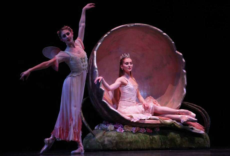 """Pacific Northwest Ballet corps de ballet dancer Jessika Anspach and principal  dancer Carla Korbes (as Titania, Queen of the Fairies) perform during a dress rehearsal for George Balanchine's """"A Midsummer Night's Dream."""" Photo: Joshua Trujillo / Seattlepi.com"""