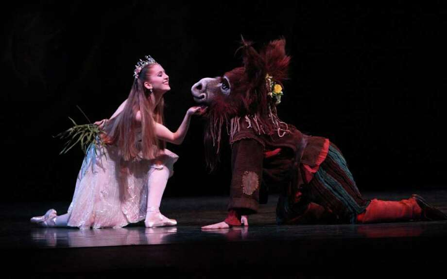 "Pacific Northwest Ballet principal dancer Carla Korbes as Titania, and corps de  ballet dancer Ezra Thomson as Bottom perform during a dress rehearsal for George Balanchine's ""A Midsummer Night's Dream."" Photo: Joshua Trujillo / Seattlepi.com"