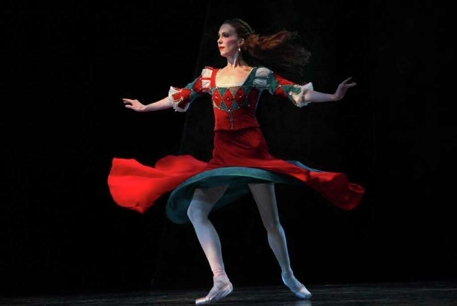 """Pacific Northwest Ballet corps de ballet dancer Kylee Kitchens as Helena performs during a dress rehearsal for George Balanchine's """"A Midsummer Night's Dream"""" at McCaw Hall in Seattle. Photo: Joshua Trujillo / Seattlepi.com"""