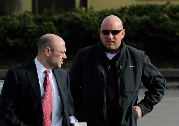 Albany Police Officer Brian Lutz, right,  arrives at the Department of Motor Vehicles building in downtown Albany, N.Y. accompanied by his lawyer Andrew Sofranko for his hearing before an administrative law judge regarding the status of his drivers license after refusing a breath-alcohol test April 8, 2011.  (Skip Dickstein / Times Union) Photo: SKIP DICKSTEIN / 00012692A