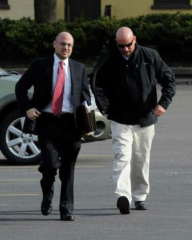 Albany Police Officer Brian Lutz, right, and his attorney, Andrew Safranko, arrive at the Department of Motor Vehicles building in downtown Albany on Friday, April 8, 2011, for a hearing before an administrative law judge to determine whether Lutz should lose his driver's license for allegedly driving while intoxicated in December. (Skip Dickstein / Times Union) Photo: SKIP DICKSTEIN / 00012692A