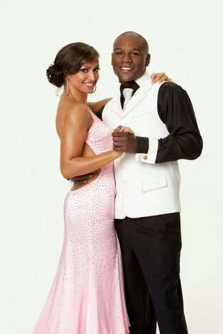 "juliecooper DANCING WITH THE STARS - FLOYD MAYWEATHER -- ""Pretty Boy"" Floyd Mayweather is a six-time world champion in five different weight classes and the current RING and World Boxing Council Welterweight Champion of the World, with an astounding undefeated record of 38-0, with 24 knockouts.  He is universally recognized as pound-for-pound the best fighter in the world. Mayweather teams with KARINA SMIRNOFF, who returns for her third season. In a ""Dancing with the Stars"" first, twelve celebrities - six men and six women -- attempt to outshine one another on a fifth season of the hit series, which returns MONDAY, SEPTEMBER 24 (8:00-9:30 p.m., ET) on ABC. (ABC/CRAIG SJODIN) KARINA SMIRNOFF, FLOYD MAYWEATHER Photo: CRAIG SJODIN, © 2007 American Broadcasting Com / © 2007 American Broadcasting Companies, Inc. All rights reserved. NO ARCHIVING. NO RESALE."